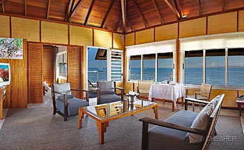 Lounge of the Overwater Bungalow at l'Escapade Island Resort